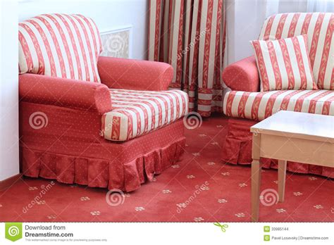 Red Striped Sofa With Pillow And Armchair Stock Photo