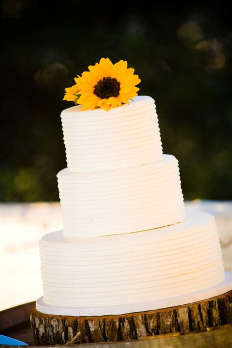Sunflowers On Simple Wedding Cake With Wood Slab Cake