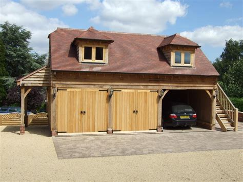 oak country buildings  big wood garage kits  red tuscany roof outdoor storage rustic