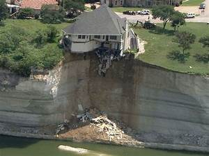 House dangling off edge of cliff set on fire
