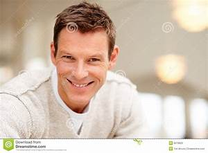 Stock Photos: Portrait of smiling handsome young man ...