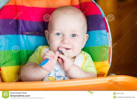 Adorable Baby Eating In High Chair Stock Photo Image