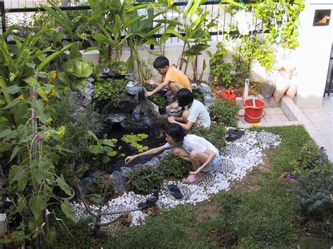 kumpulan foto gambar kolam ikan depan rumah minimalis