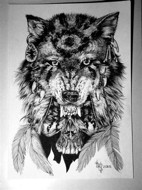 Native black-and-white wolf over skull tattoo design