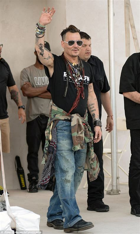 johnny depp is all smiles as he waves to fans before his coney island gig daily mail