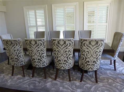 parquetry dining table with upholstered dining chairs