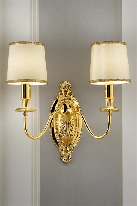 wall light in gold plated bronze with beige silk