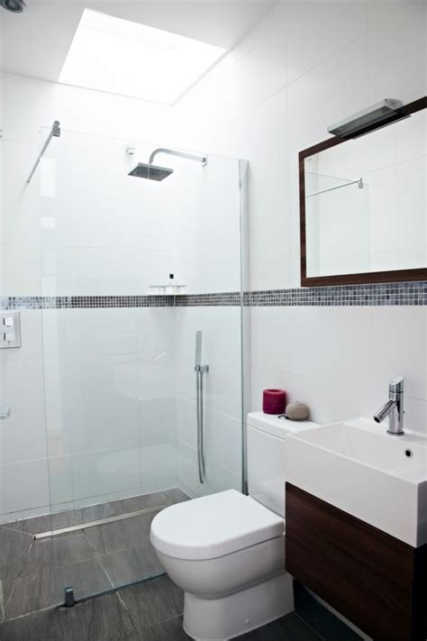 simple bathroom design house with floor to ceiling glass and beautiful nature views