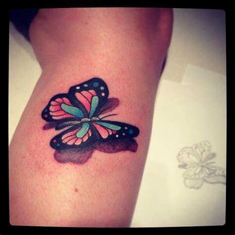 small butterfly  artful body tattoos