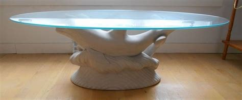 Cast in quality designer resin. Whimsical glass top oval coffee table w/ white dolphin base | Oval coffee tables