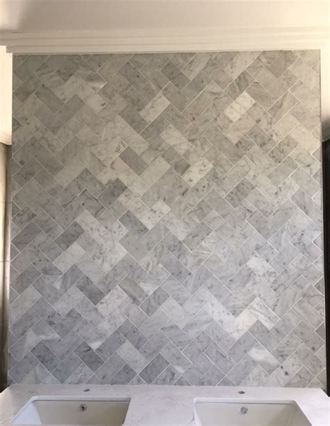 herringbone wall tiles herringbone feature wall in marble tiles 1609
