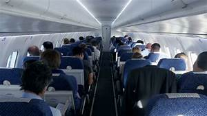 inside airplane. passengers siting in plane. air travel ...