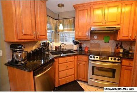 yellow orange kitchen cabinets yellow orange oak cabinets