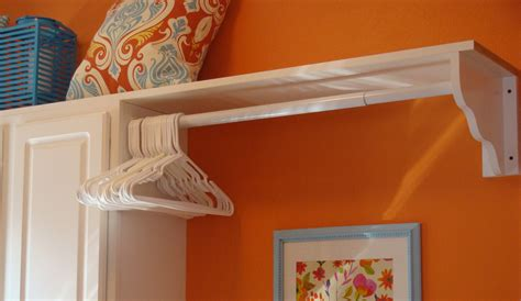 wooden shelf with hanging rod shelf with hanging rod extend your storage homesfeed