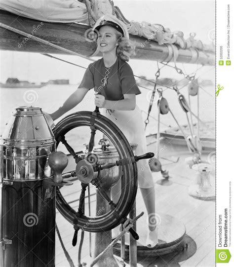 portrait  woman steering boat stock photo image