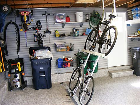 Garage Organization Ideas For Bikes by 3 Car Garage Auto Lift Slatwall Organization