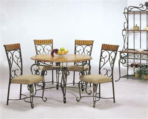 ornate wrought iron chairs with stylish table for