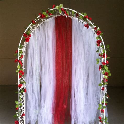 diy lighted wedding arch with roses and tulle wedding