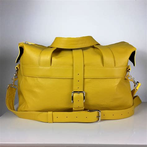 personalised handcrafted yellow leather travel bag by ...