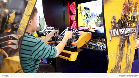 Kids Are Playing In Sega Transformers Video Arcade Game In