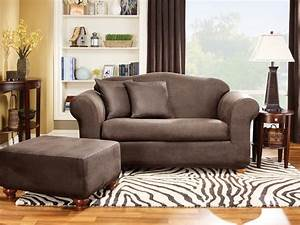 Unbelievable slipcovers for living and dining rooms hgtv for Sofa slipcovers for leather furniture