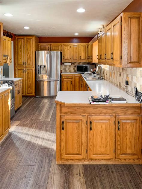 An alternative to preserving the look of oak is to take the plunge and paint your kitchen cabinets in an appealing shade. Honey oak kitchen cabinets-03 - Painted by Kayla Payne