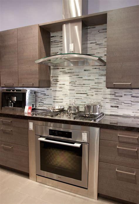 kitchen glass chimney hood gray backsplash   Kitchen Ideas