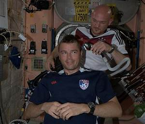 Two NASA astronauts shave off their hair after losing bet ...