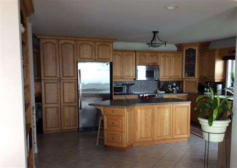 how to make kitchen cabinets look better 4 ideas how to update oak wood cabinets 9487