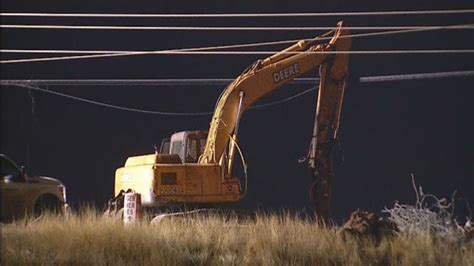 track hoe tangled  power lines  yukon power outage