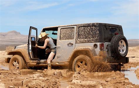 muddy jeep jeep wrangler jk stuck knee deep in mud off road xtreme
