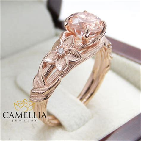 Nature Inspired Rose Gold Engagement Ring From Camellia. Emerald Pendant. Snake Chains. Amber Rings. Shared Prong Diamond Eternity Band. Martini Stud Earrings. Brown Diamond. Seafoam Green Earrings. Blue Sapphire Rings