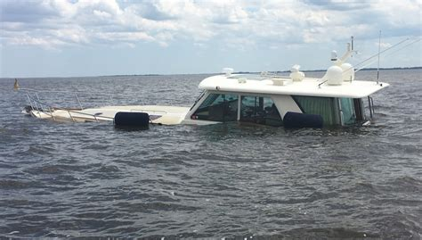 Sinking Boat by Two Rescued From Sinking Boat In Intercoastal Waterway In