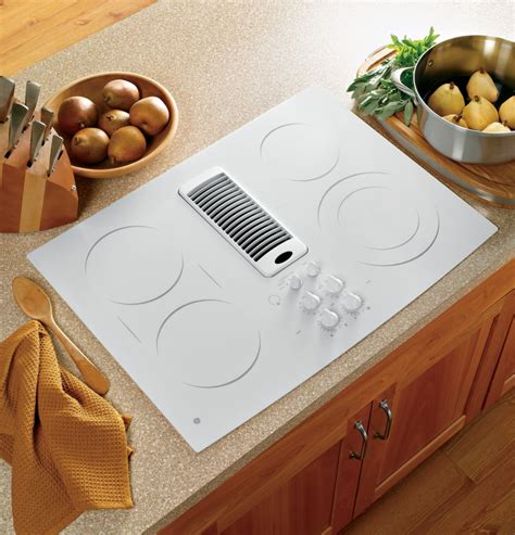 ge pptnww   smoothtop electric downdraft cooktop   cfm  speed fan  ribbon