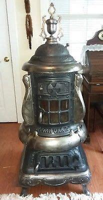 antique cast iron acorn oak  parlor stove stove pot