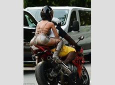 Rihanna straddles motorcycle for music video shoot in