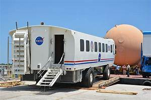 Space shuttle external fuel tank, astronaut mover on barge ...