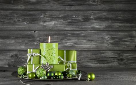christmas gifts  green candles  wooden background