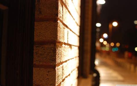 brick wall close  blurry street  night