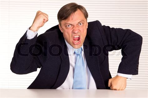 12256 angry businessman stock photo angry businessman portrait stock photo colourbox