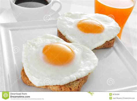 Heart shaped Fried Eggs, Bread And Orange Juice Stock Photo   Image: 36784380