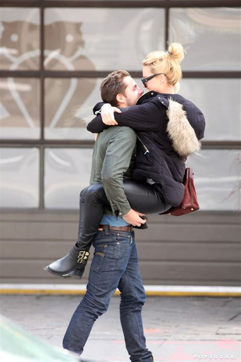 margot robbie straddles  kisses tom ackerley pictures