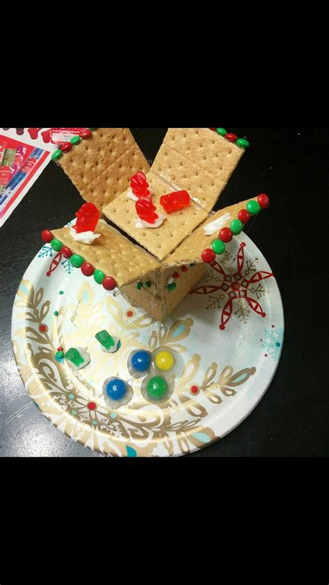 nephew   gingerbread house   differently
