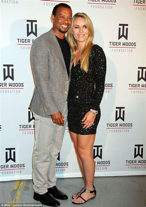 Tiger Woods leans on skier girlfriend Lindsey Vonn as he ...