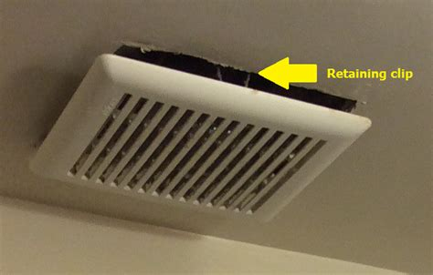 removing  cover   bathroom exhaust vent fan