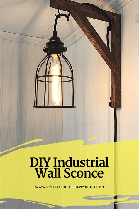 diy industrial wall sconce using a caged hanging pendant