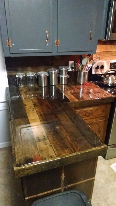 25 best ideas about epoxy countertop on bar