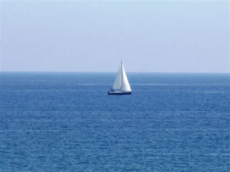 Small Boat On The Ocean by Sail Boat Ocean View Costa Del Sol Spain Photograph By