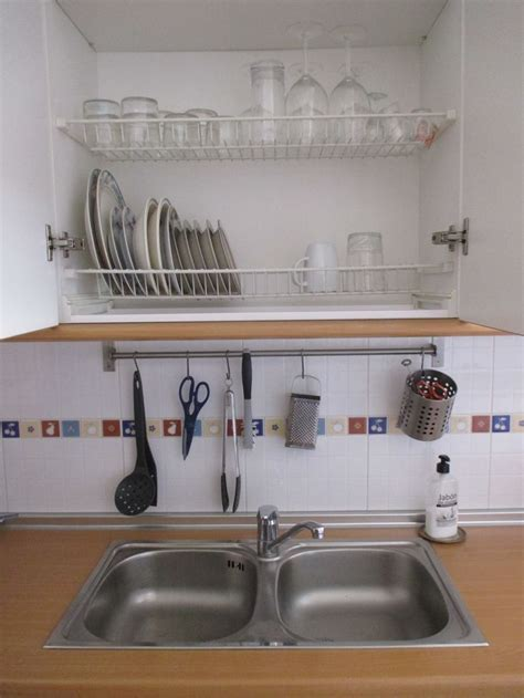 spanish favorites dish drain cupboard kitchen sink design apartment kitchen interior