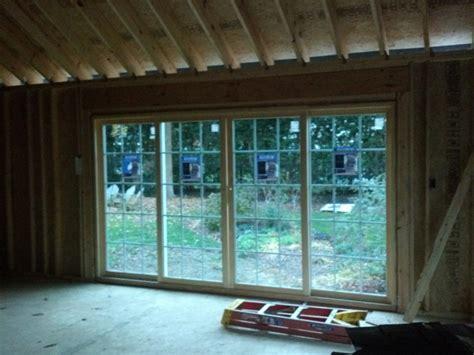 putting in patio doors installing new header for 16 ft sliding glass door living